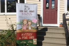 Mystery at Pine Lake event sign